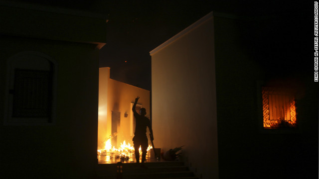 A protester reacts as the U.S. Consulate in Benghazi is seen in flames Tuesday night.  Armed gunmen attacked the compound on Tuesday evening, clashing with Libyan security forces before the latter withdrew as they came under heavy fire.