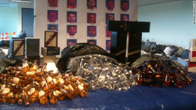 Prosecutors say 15 employees of LSG pilfered bottles of alcohol left over from various American Airlines flights and sold them.