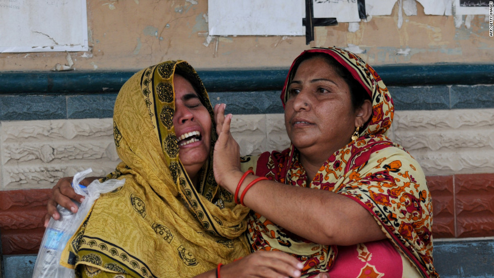 More than 280 Pakistanis perished in horrific fires that destroyed two factories in Karachi, Pakistan on Tuesday, September 12, 2012. The  unprecedented industrial tragedy prompted calls Wednesday for an overhaul of poor safety standards.  Pakistani women grieve as they wait at the morgue to identify their relatives who died in one of the fires.