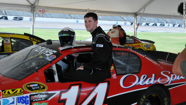 Staff Sgt. Jason Thompson perches on the window of Tony Stewart's No. 14 car at Texas Motor Speedway.