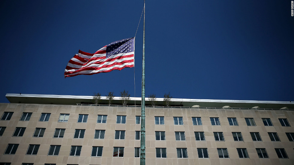 An American flag flies at half staff outside the State Department in Washington on Wednesday, September 12, a day after U.S. ambassador to Libya J. Christopher Stevens and three other embassy employees were killed when the consulate in Benghazi was attacked.