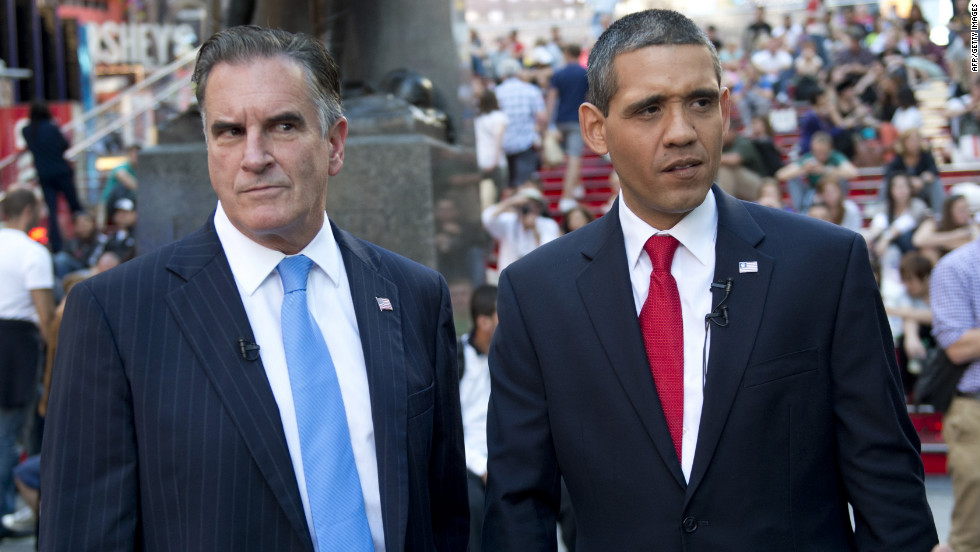 Mike Cote, left, and Louis Ortiz impersonate Republican presidential candidate Mitt Romney and President Barack Obama at Times Square in New York on Tuesday, September 11.  As the election draws nearer, the impersonators keep a full schedule.