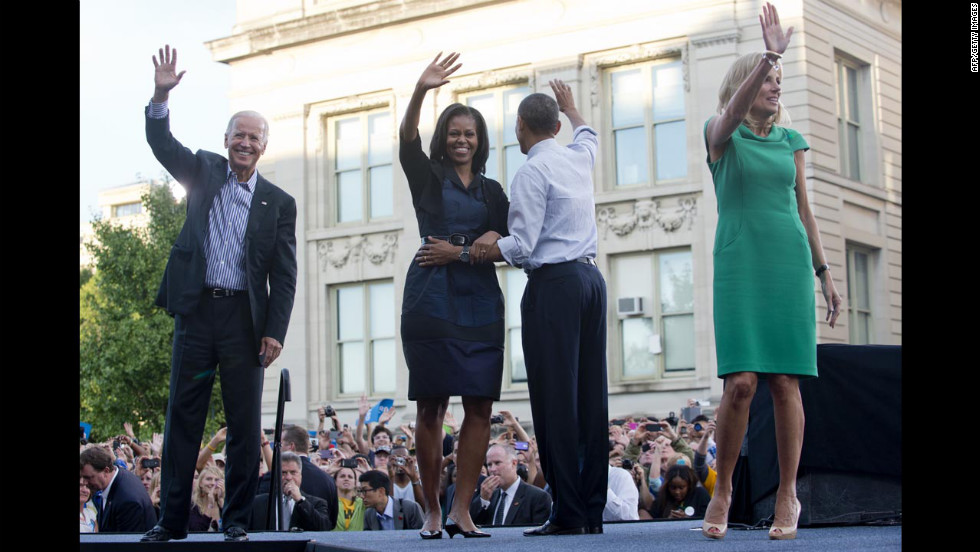 Vice President Joe Biden, first lady Michelle Obama, President Obama and Biden's wife, Jill, wave after Friday's campaign event at the University of Iowa.