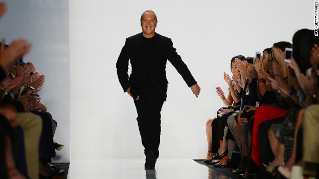 Designer Michael Kors appears at the end of his show during New York fashion week on September 12, 2012.