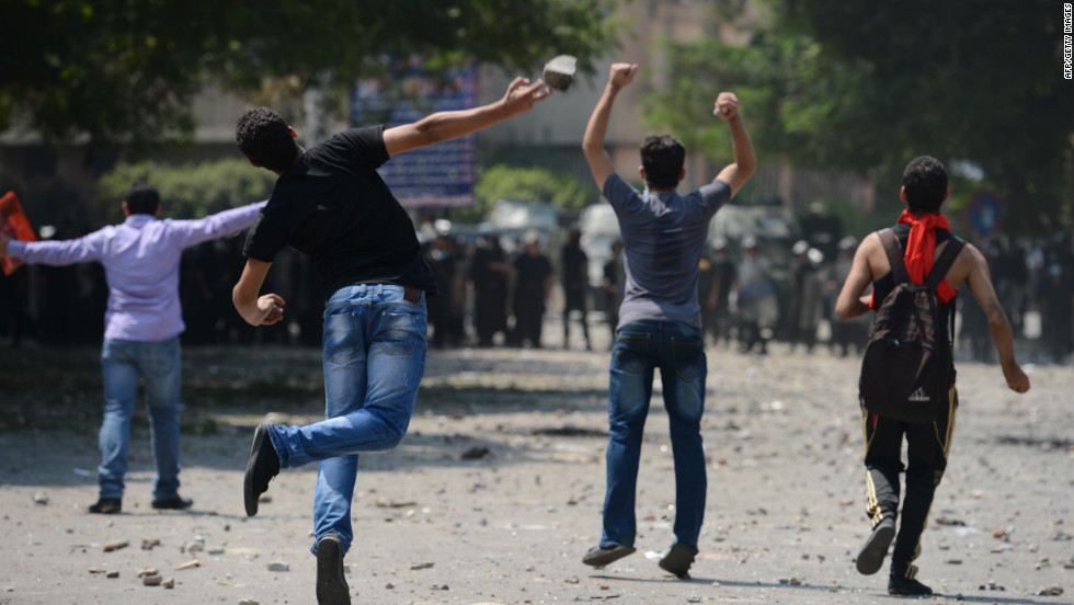 Egyptian protesters clash with riot police Thursday near the U.S. Embassy in Cairo.