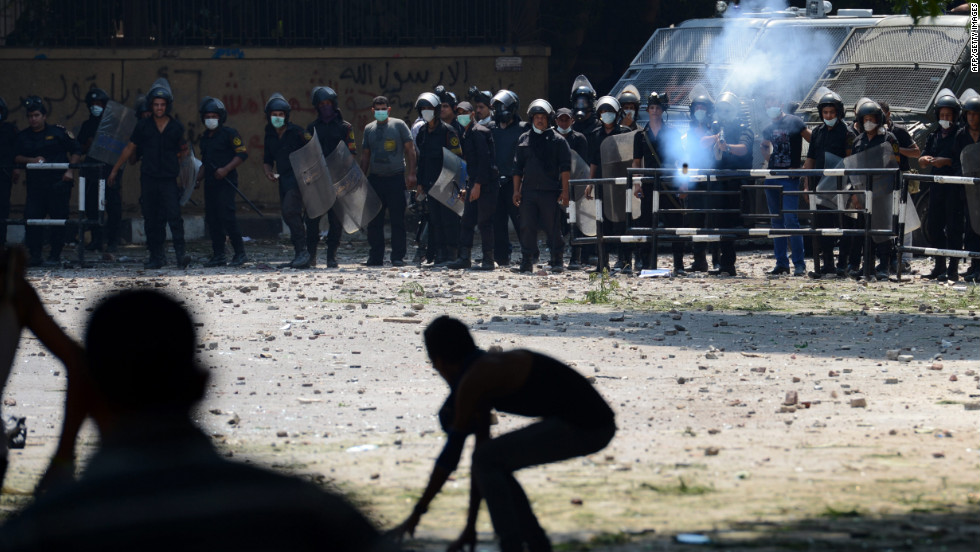 An Egyptian riot police officer fires tear gas toward protesters during clashes Thursday with police near the U.S. Embassy in Cairo.
