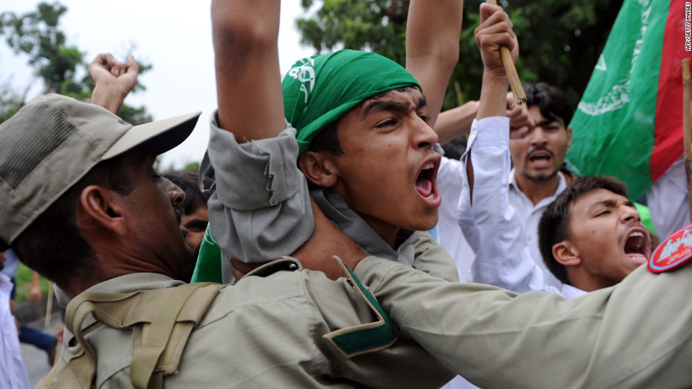 Muslim protesters shout outside the U.S. Embassy in Islamabad, Pakistan, on Friday.