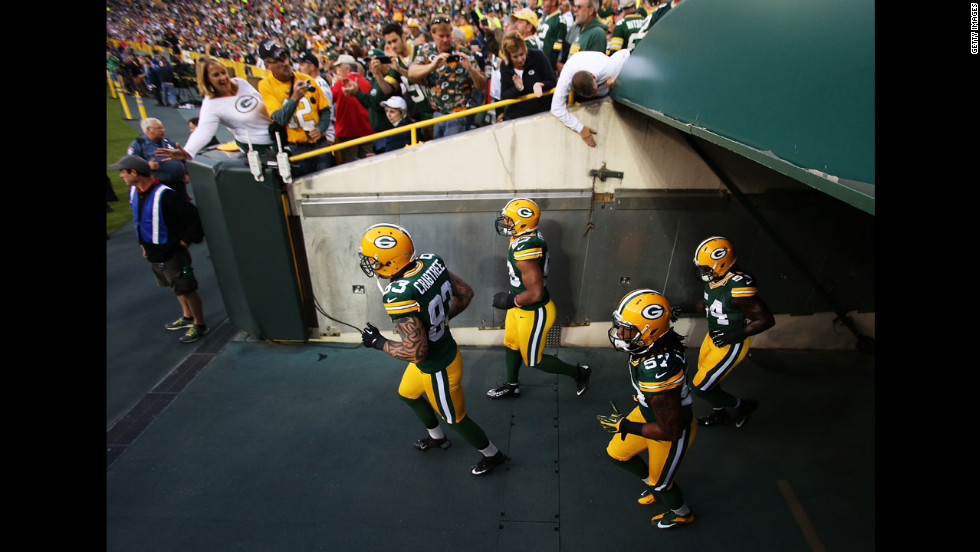 "Tight end Tom Crabtree of the Green Bay Packers, left, leads teammates onto the field for warm-ups before their game against the Chicago Bears. <a href=""http://www.cnn.com/2012/09/09/worldsport/gallery/nfl-week-1/index.html"">Look back at Week One of the NFL</a>."