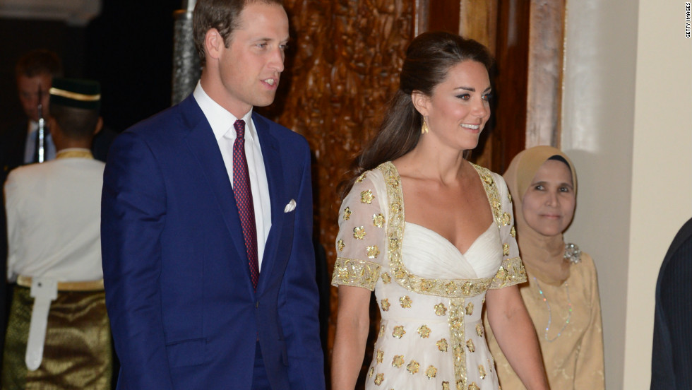 The Duke and Duchess of Cambridge attend an official dinner hosted by Malaysia's Head of State Sultan Abdul Halim Mu'adzam Shah of Kedah at the Istana Negara on Thursday in Kuala Lumpur, Malaysia. The duchess' evening gown, by Alexander McQueen, features the Malaysian flower, hibiscus, in gold detail.