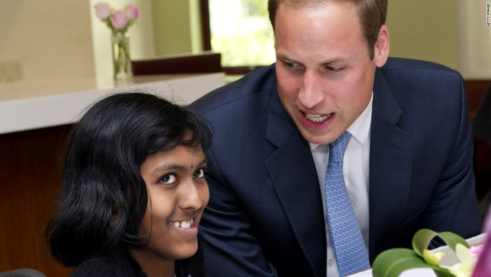 Britain's Prince William speaks with Linges Warry Apparad, a 14-year-old with leukemia, at Hospis Malaysia Thursday in Kuala Lumpur, Malaysia.