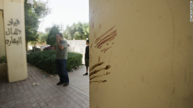 Hand prints in blood on embassy walls