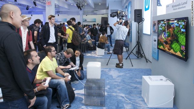 "Members of the gaming media play ""Nintendo Land"" at a press event for the Nintendo Wii U on Thursday."