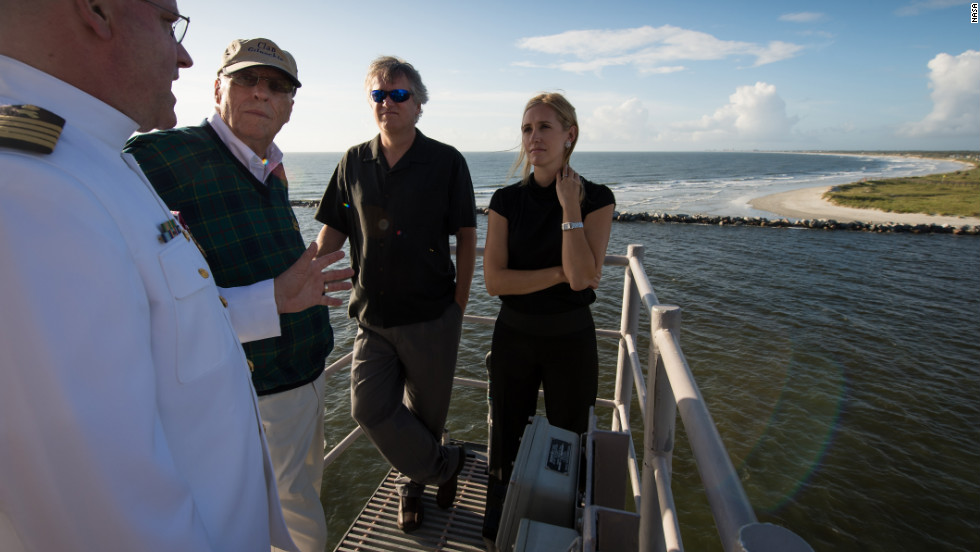 "From left to right: Navy chaplain, Capt. Donald P. Troast, left, talks with Dean Armstrong, brother of the late Neil Armstrong, Eric ""Rick"" Armstrong, Neil Armstrong's son, and Molly Van Wagenen, Neil Armstrong's stepdaughter, from the top of the Navy ship as it departs from Mayport, Florida, a for the service."
