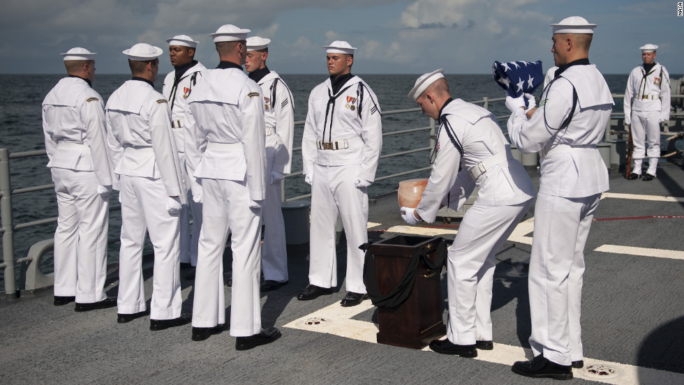 U.S. Navy personnel carry the remains of Apollo 11 astronaut Neil Armstrong during a burial at sea service aboard the USS Philippine Sea on Friday, September 14, in the Atlantic Ocean. Armstrong, the first man to walk on the moon on the Apollo 11 mission in 1969 died August 25 at age 82.