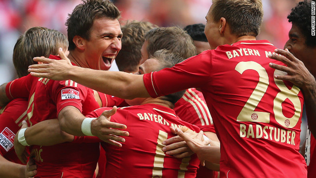 Mario Mandzukic (left) celebrates with his teammates after putting Bayern ahead in the second minute against Mainz