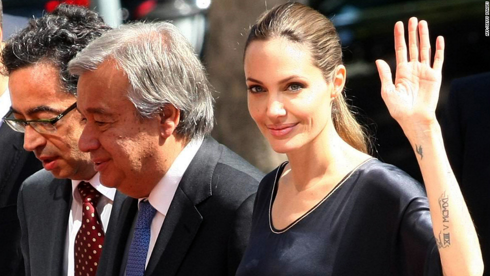 Jolie and U.N. High Commissioner for Refugees Antonio Guterres, center, arrive on Thursday to meet with the Turkish deputy prime minister in Ankara.