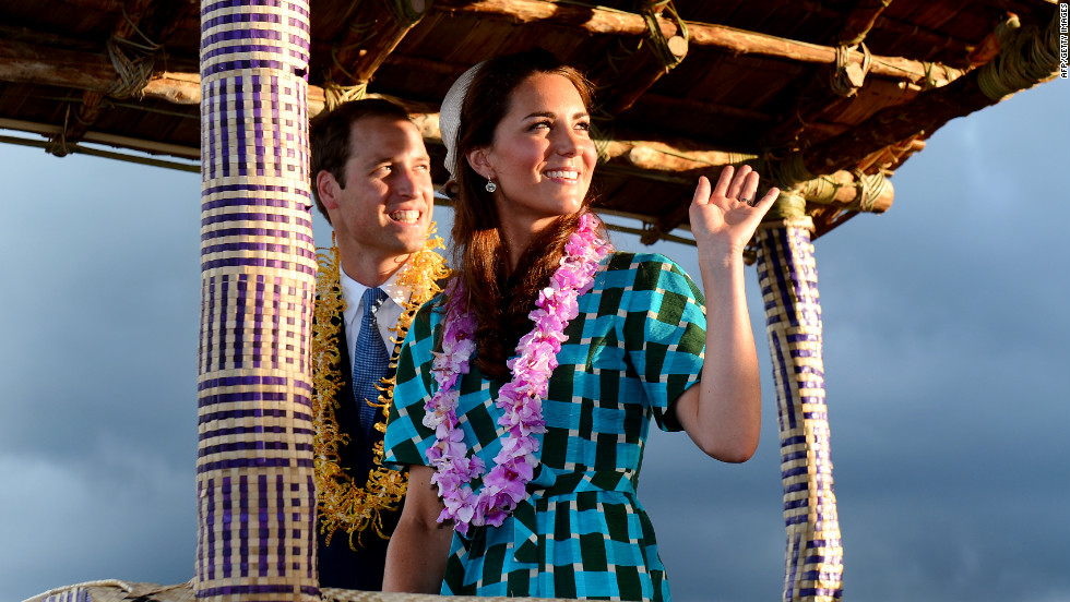 Britain's Prince William and his wife, Catherine, Duchess of Cambridge, wave to Solomon Islanders as they leave the airport aboard a truck decorated as a canoe in Honiara on Sunday.