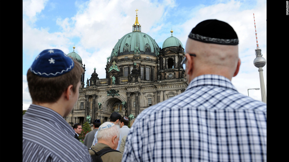 Men wearing traditional Jewish headwear, kippahs, take part in a demonstration in Berlin on Saturday, September 15. The kippah walk, spurred from an online initiative, was aimed against anti-Semitism and took place on Rosh Hashanah.