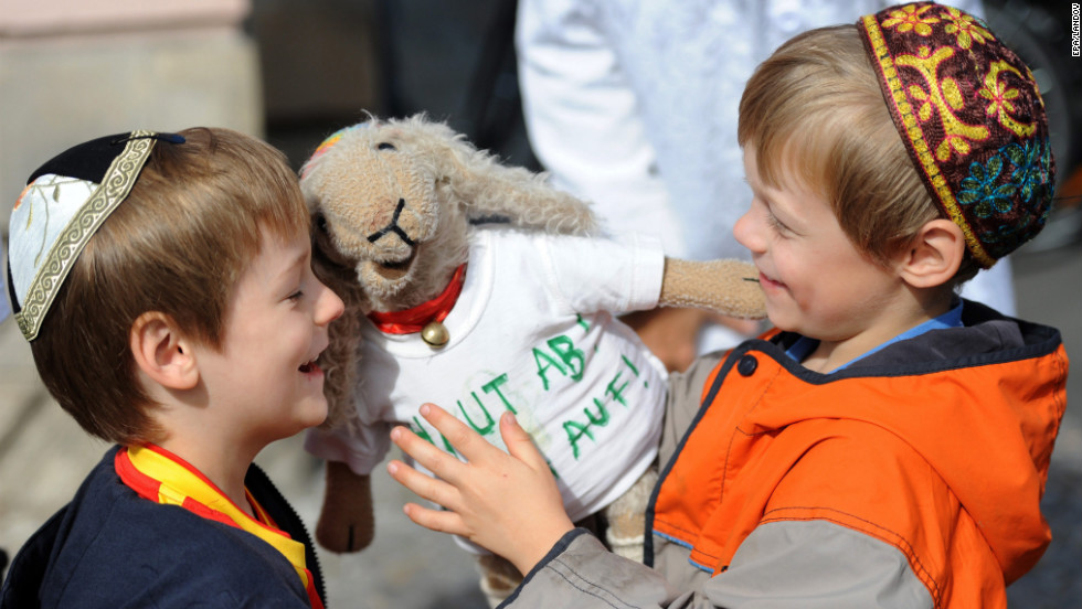 Joshua, left, and Levin wear traditional play with a stuffed animals during a demonstration called the kippah walk in Berlin on Saturday.