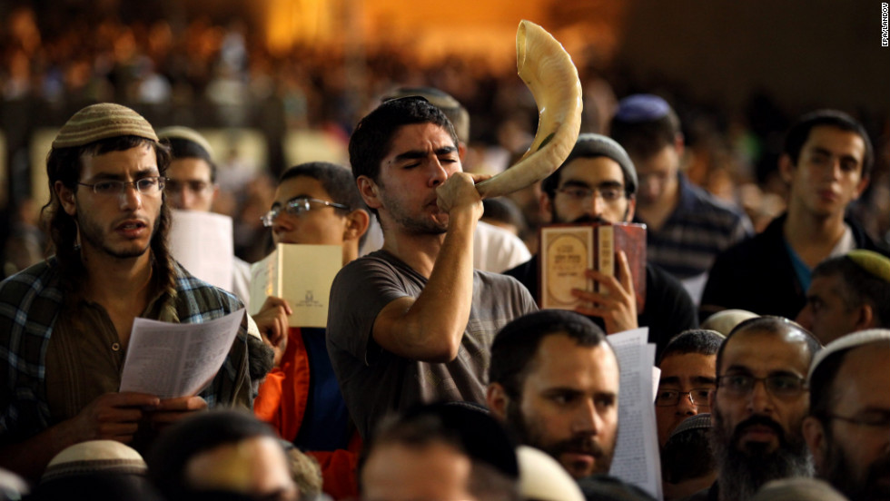 A Jewish Orthodox man blows a shofar while hundreds of Jews attend Selichot prayers, at the Western Wall in Jerusalem's Old City, Israel, early Wednesday, September 12. According to the local media, this specific prayer is dedicated to ask for God's protection from the possibility of Israeli attack on Iran's nuclear facilities.