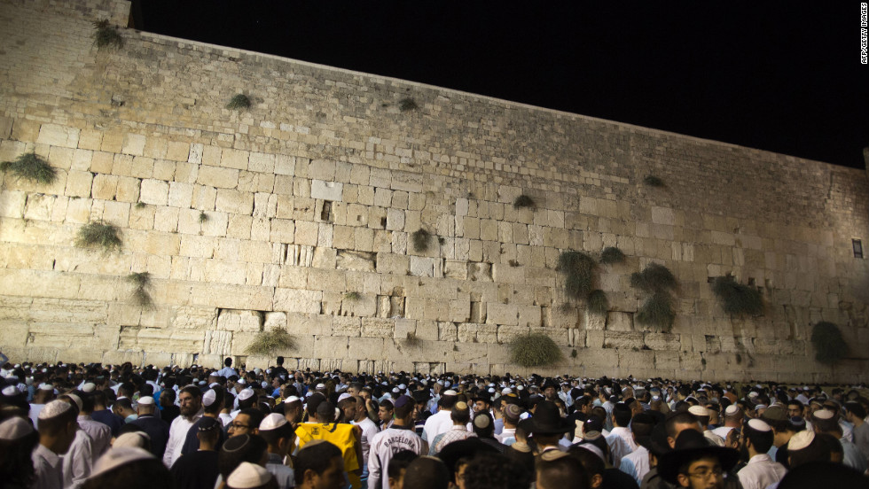Thousands of religious Jews participate in the Slichot, or forgiveness, prayer at the Western Wall, Judaism's holiest site, in the old city of Jerusalem on Sunday, the eve of the Jewish New Year. According to the Jewish calendar, the world has existed for 5,772 years.