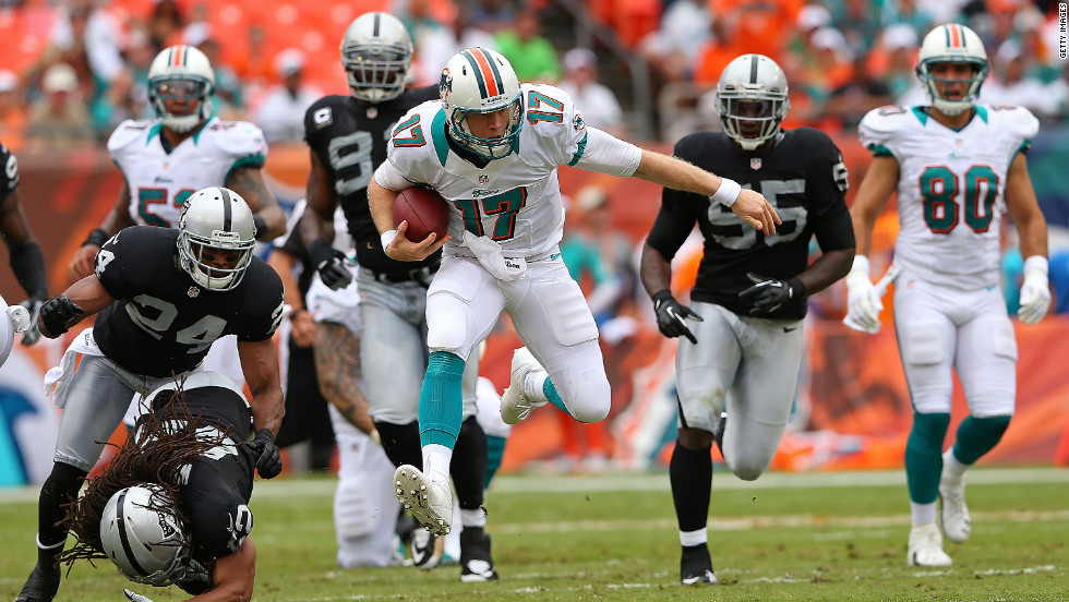 Ryan Tannehill of the Miami Dolphins rushes during a game Sunday against the Oakland Raiders.