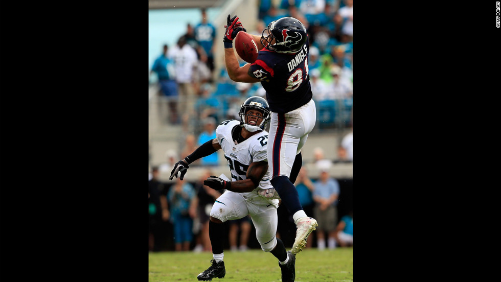 Owen Daniels of the Houston Texans attempts to catch a pass Sunday against Dwight Lowery of the Jacksonville Jaguars at EverBank Field in Jacksonville, Florida.
