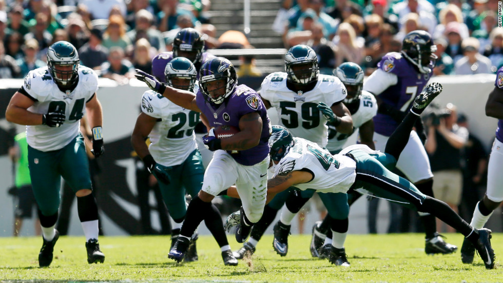 Running back Ray Rice of the Baltimore Ravens rushes for a long gain against the Philadelphia Eagles during the first half Sunday.