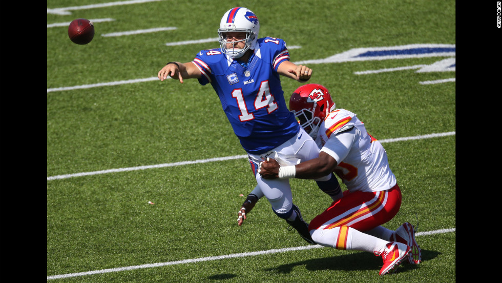 Quarterback Ryan Fitzpatrick of the Buffalo Bills throws the ball as he is tackled by Justin Houston of the Kansas City Chiefs on Sunday.