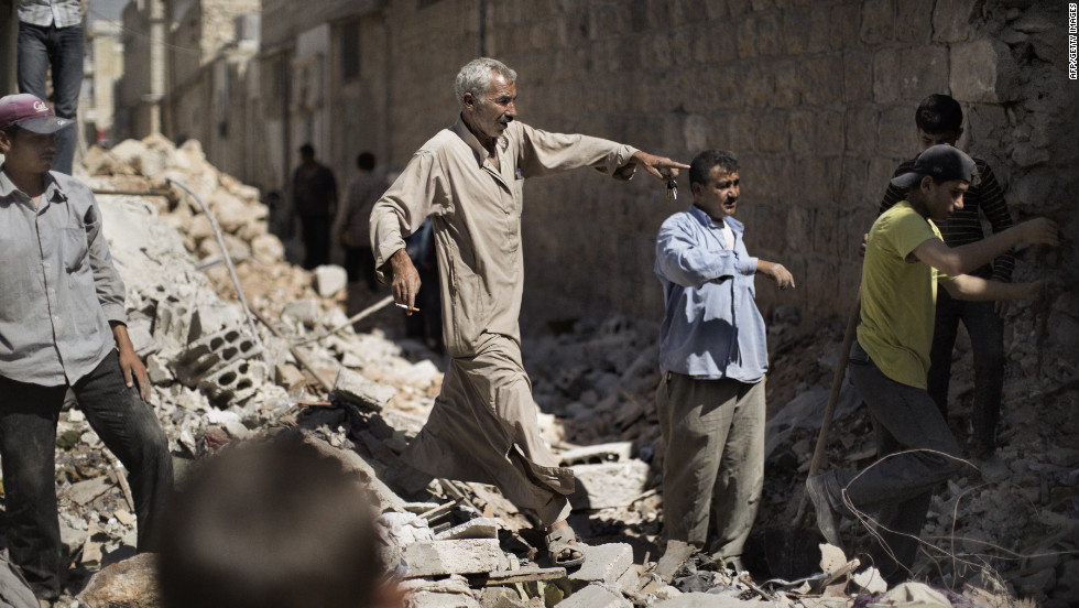 Syrian men sift through the rubble of houses in al-Bab on Saturday.