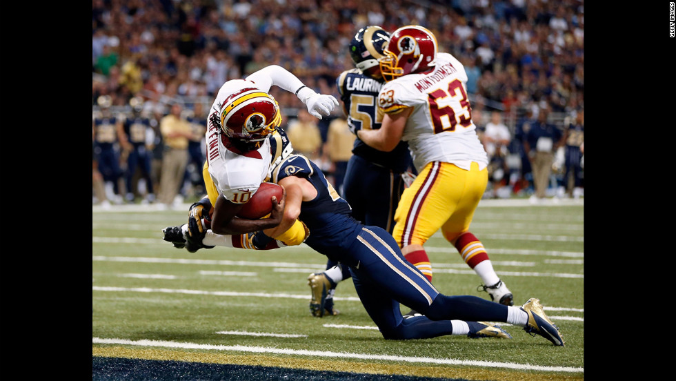 Quarterback Robert Griffin III of the Washington Redskins lunges over the goal line Sunday for a touchdown against the St. Louis Rams at Edward Jones Dome in St. Louis.