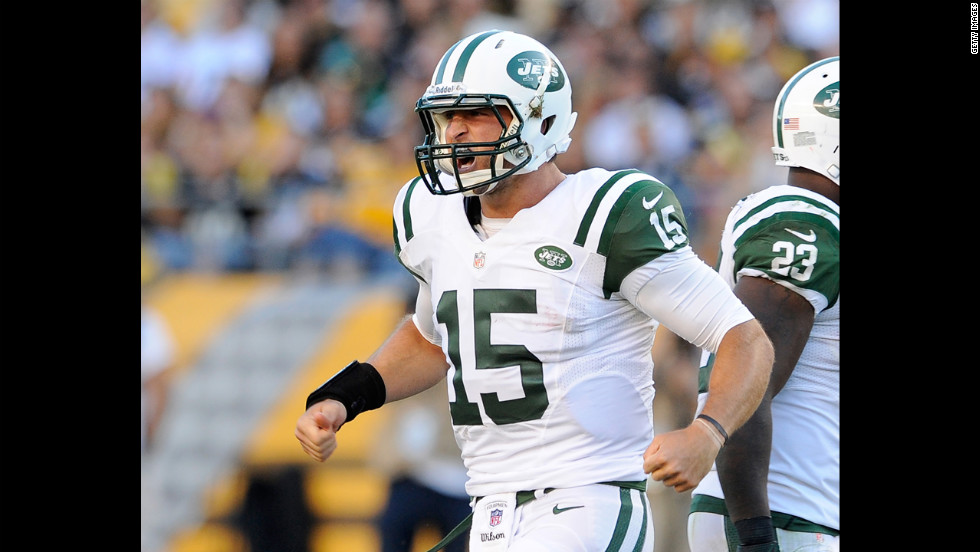 Tim Tebow of the New York Jets reacts after running for a first down against the Pittsburgh Steelers on Sunday.