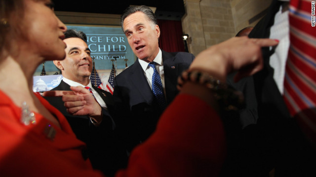 Mitt Romney and Hector Barreto Jr., chairman of the Latino Coalition, greet guests at the U.S. Chamber of Commerce in Washington in May.