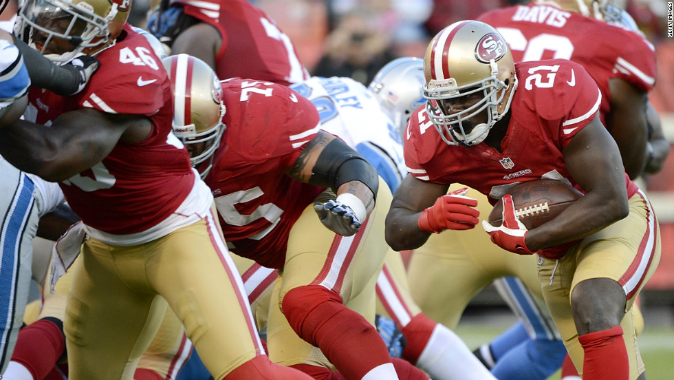Frank Gore of the San Francisco 49ers carries the ball for a one-yard touchdown run in the second quarter against the Detroit Lions on Sunday, September 16, at Candlestick Park in San Francisco.