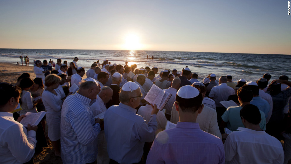 Jews gather at the edge of the Mediterranean Sea in Ashdod, Israel, on Monday to recite the Tashlich prayer.