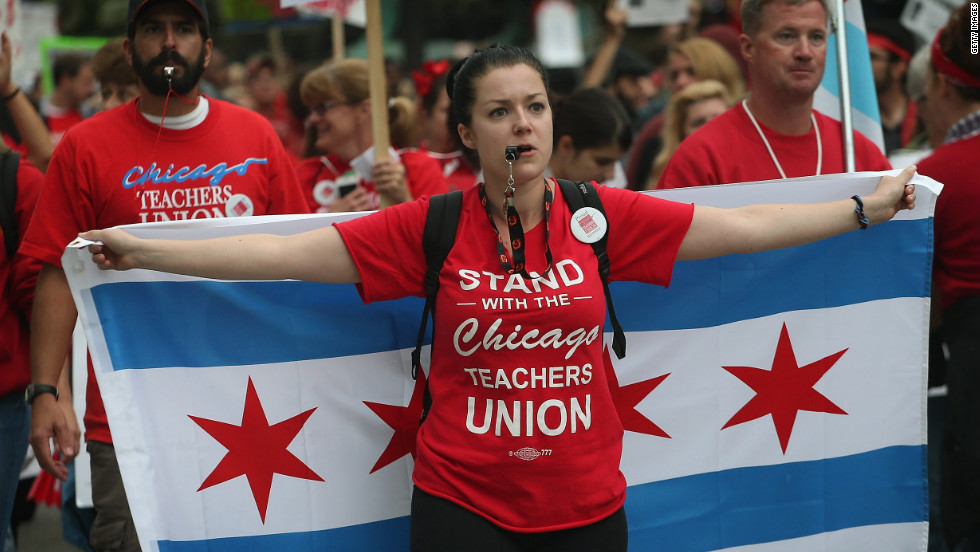 Striking teachers and their supporters march down Michigan Avenue on Thursday, September 13.