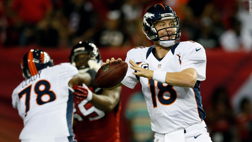 Peyton Manning of the Denver Broncos looks to pass in Monday's game against the Atlanta Falcons.