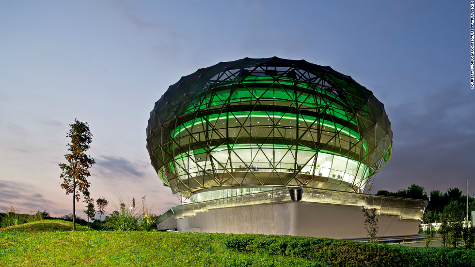 Sandwiched between two highways, this golf ball-shaped building houses offices of Italian light-maker iGuizini. Its facade is covered by a fabric cloak to protect it from direct sunlight while at night, the building turns into a shining sphere.<br /><em>Designed by: Josep Miàs, Spain </em>
