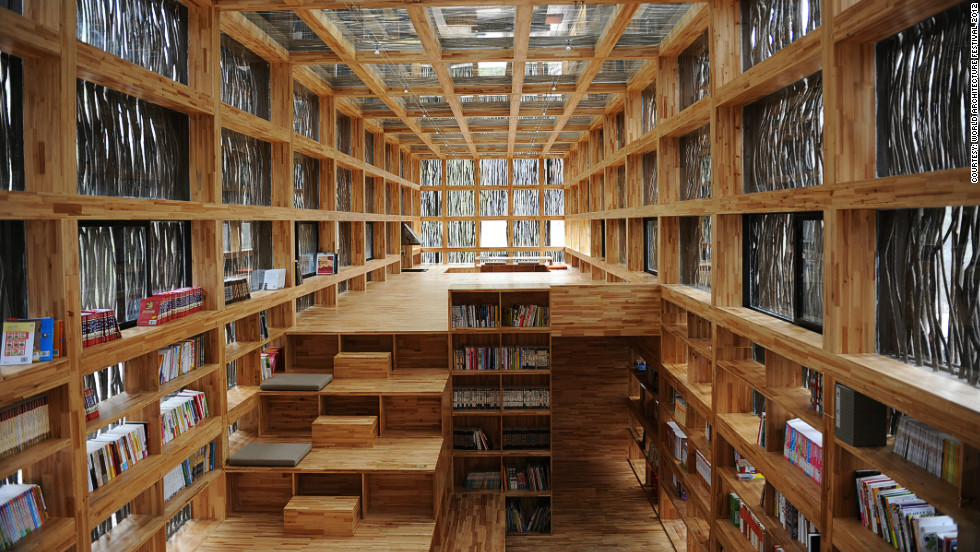 Located on the outskirts of Beijing, the single-storey Liyuan Library is cloaked in firewood so as to blend in with the surrounding tree life.<br /><em>Designed by: Li Xiaodong, China</em>