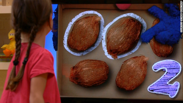 """In """"Kinect Sesame Street TV,"""" characters will ask viewers questions about, say, how many coconuts are displayed."""