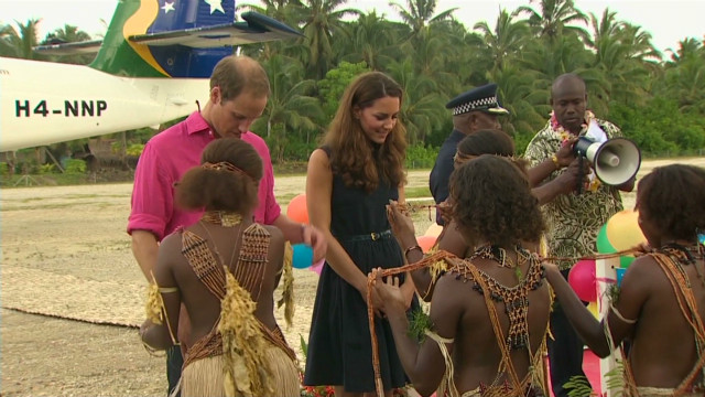 Will and Kate greeted by topless dancers