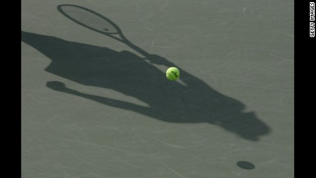 SEOUL, SOUTH KOREA - SEPTEMBER 18:  A shadow is cast acroos the court as Caroline Wozniacki of Denmark serves during her match against Arantxa Ros of Netherlands during day one of the KDB Korea Open at Olympic Park Tennis Stadium on September 18, 2012 in Seoul, South Korea.  (Photo by Chung Sung-Jun/Getty Images)