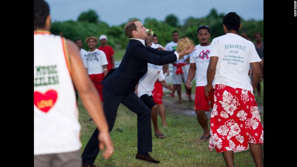 Prince William plays a local game called Te Ano on Tuesday, September 18, in Tuvalu.