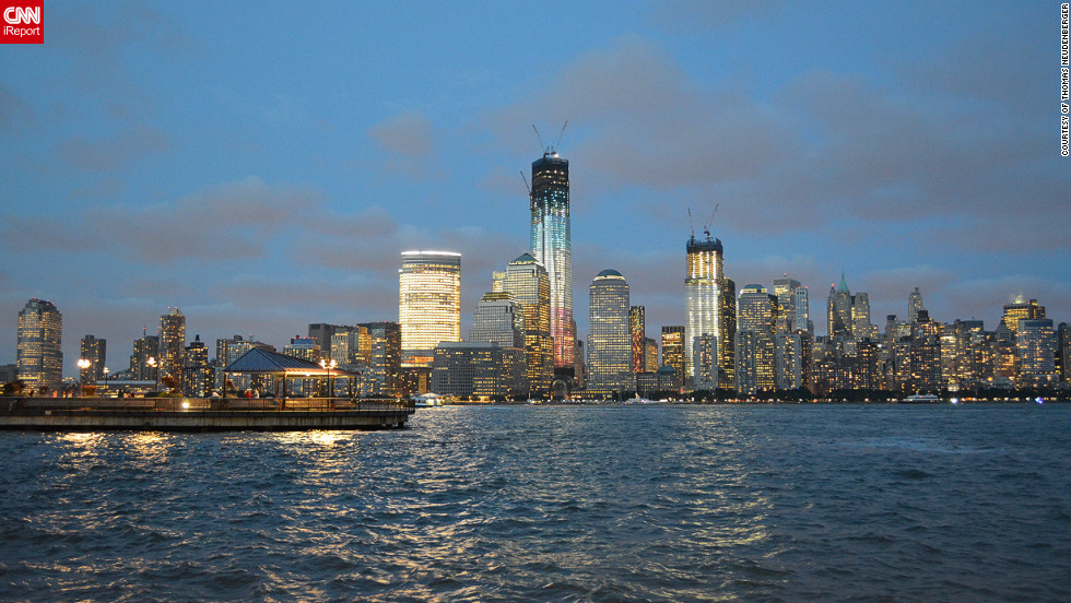 """Thomas Neudenberger took this picture the New York skyline on June 18th, 2012 after """"a wonderful day in the city"""" he says. """"My wife and I spent the same day in June 2001 and finished it up with a trip to the New Jersey shore line. My wife didn't understand, why we took the boat trip until I told her to turn around and she saw the original World Trade Center in the sunset. We had a couple drinks and looked at the city for hours."""""""