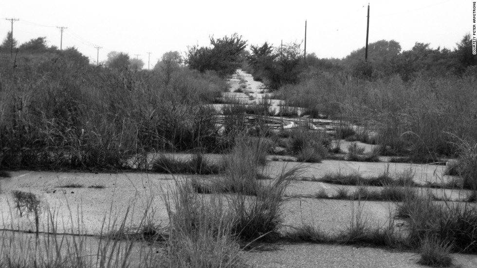 When going through the various towns in its path, the exact location of Route 66 was often moved from one street to another, leaving behind abandoned local roads like this one in Missouri.