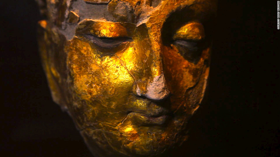 A gold-plated Buddha head found at Mes Aynak. A team of international archaeologists is scrambling to save relics.