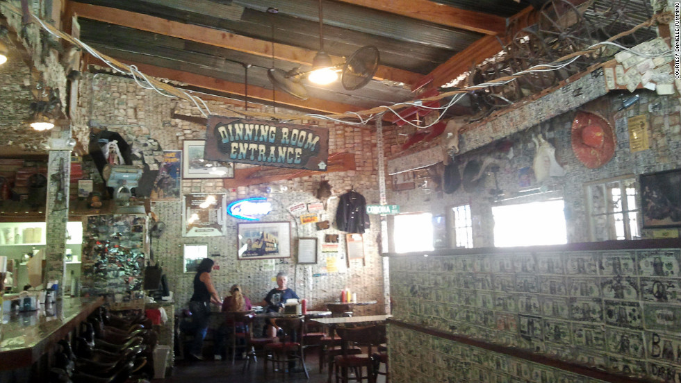 Currency serves as wallpaper in the dining room of the Tortilla Flat saloon.