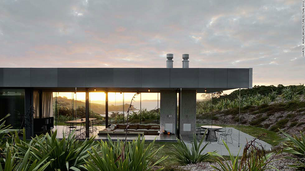 "Perched on a hilltop facing New Zealand's Hauraki bay, the aptly named ""Island Retreat"" capitalizes on the area's extreme weather conditions, with extensive solar generation and a rainwater harvesting system.<br /><em>Designed by: Fearon Hay Architects, New Zealand</em>"