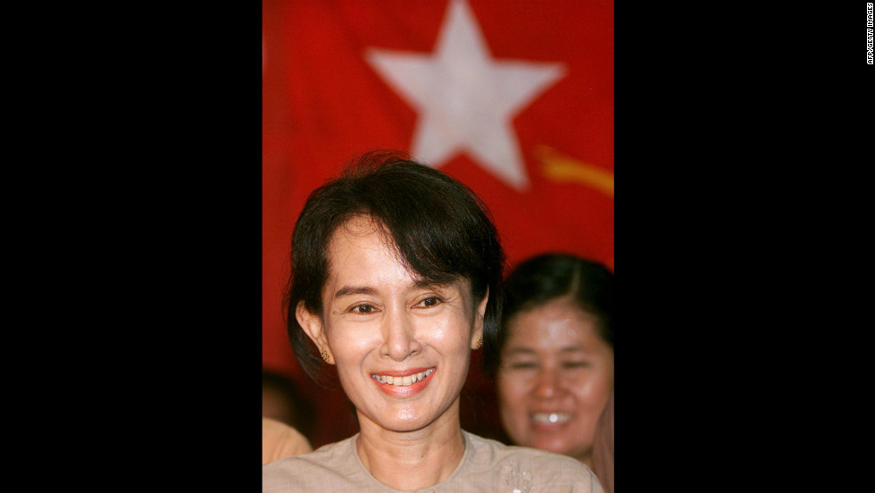 Suu Kyi listens to a question during a news conference after being freed from 19 months under house arrest May 6, 2002, making a triumphant return to her party's headquarters in Yangon. A year later, her motorcade was attacked by a pro-government mob, and she was placed under house arrest again.