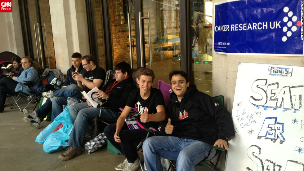 "Alexandre Marchetti walked by the Apple store in London's Covent Garden on Thursday and <a href=""http://ireport.cnn.com/docs/DOC-844355"">shot this photo</a> of a man offering a seat for sale at the front of the iPhone 5 line to raise money for cancer research. It's going for 600 pounds, or nearly $1,000 U.S. dollars. The man has been waiting since Friday."